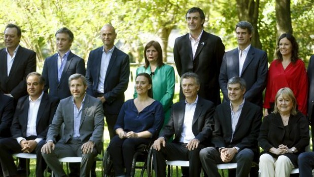 Argentina's President-elect Mauricio Macri (seated C) next to vice-elect president Gabriela Michetti (2nd L), poses with members of his cabinet in Buenos Aires, December, 2, 2015. Macri on Wednesday expressed confidence a deal could be reached next year with U.S. creditors suing the country over unpaid debt. Standing back row from left are: Tourism Minister Gustavo Santos, General Secretary Fernando de Andreis, Transport Minister Guillermo Dietrich, Security Minister Patricia Bulrich, Education Minister Esteban Bulrich, Finance MinisterAlfonso Prat-Gay and Social Development Carolina Stanley. Seated from left are: Defense Minister Julio Marinez,  Interior Minister Rogelio Frigerio,  Chief Cabinet Marcos Pena and Foreign Minister Susana Malcorra. REUTERS/Enrique Marcarian